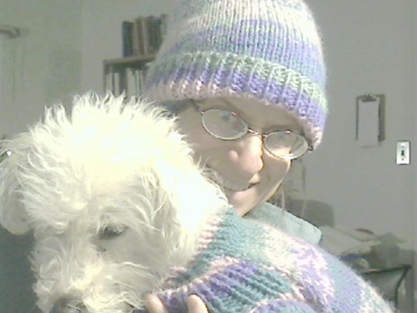 I just finished knitting the hat to match Puzzle's Coat of Many Colors, also designed and knitted by me.